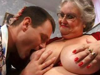fat grandma in red with large breasts acquires